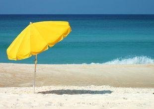 Paxade plats på stranden – fick böta